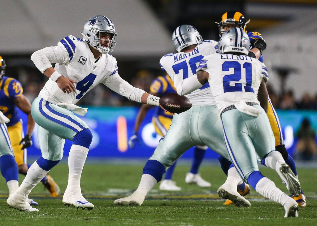 Dallas Cowboys quarterback Dak Prescott (4) hands off to running back Ezekiel Elliott (21) during the first half of a NFC divisional playoff game between the Dallas Cowboys and the Los Angeles Rams on Saturday, Jan. 12, 2019 at Los Angeles Memorial Coliseum in Los Angeles. (Ryan Michalesko/The Dallas Morning News)