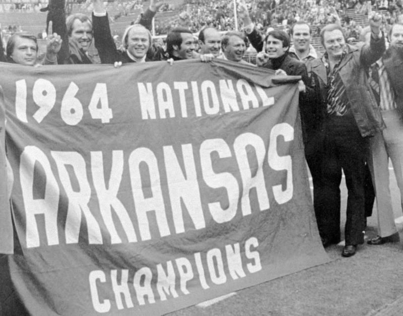 Jerry Jones is shown, far right, in a Jan. 1, 1965 photo  with other University of Arkansas football players after winning  the 1965 Cotton Bowl (to end the 1964 season). Jerry Jones, owner of the Dallas Cowboys, parted company with head coach Jimmy Johnson on Tuesday.