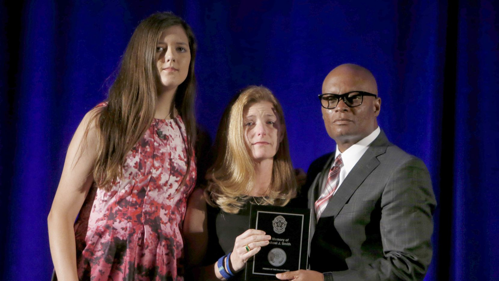 Former Dallas Police Chief David Brown gives Heidi Smith (center) and her daughter Victoria Smith the Police Cross in memory of her husband Sgt. Michael Smith during the Friends of Dallas Police awards banquet at the Hyatt Regency Dallas on Nov. 1, 2016.