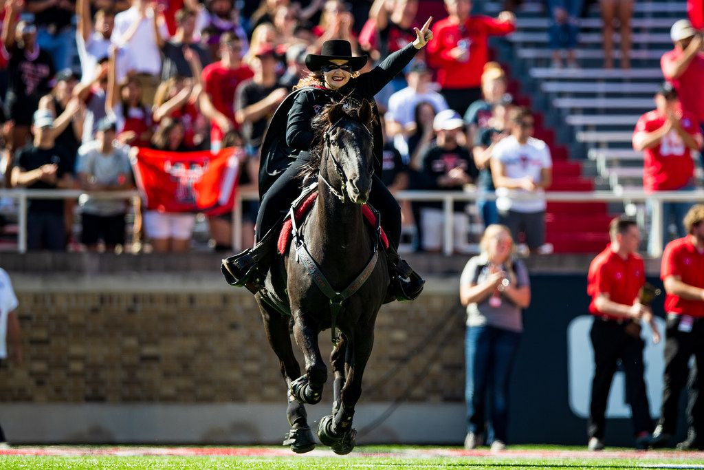 The Masked Rider, mascot of the Texas Tech Red Raiders, leads the team onto the field before the college football game between the Texas Tech Red Raiders and the Oklahoma State Cowboys on October 05, 2019 at Jones AT&T Stadium in Lubbock, Texas.