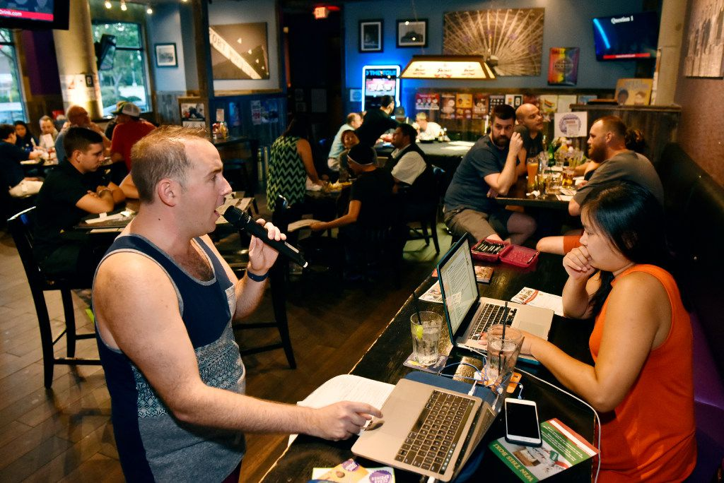 Jason Warren, left, has been hosting Geeks Who Drink trivia since 2011. Nellie Kuh, right, keeps score on Tuesday nights and hosts trivia at other venues in D-FW on other nights.