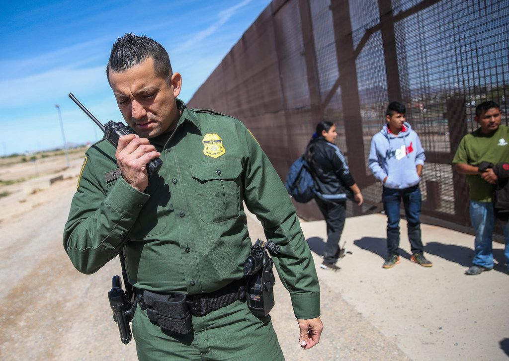 U.S. Border Patrol agents take into custody a group of Central American asylum seekers who crossed into the United States from Mexico on Thursday, April 4, 2019 in El Pasos.
