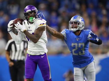 DETROIT, MICHIGAN - OCTOBER 20: Stefon Diggs #14 of the Minnesota Vikings catches a pass in front of Darius Slay #23 of the Detroit Lions at Ford Field on October 20, 2019 in Detroit, Michigan. (Photo by Gregory Shamus/Getty Images)