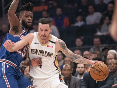 New Orleans Pelicans guard JJ Redick (4) drives against New York Knicks guard Reggie Bullock (25) during the first half of an NBA basketball game, Friday, Jan. 10, 2020, at Madison Square Garden in New York.