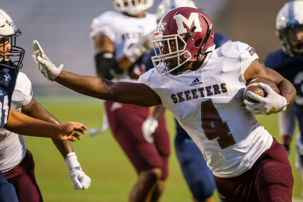 Mesquite running back  LaDarius Turner (4) pushes past L.D. Bell linebacker Marcos Echavarria (31) on a 36-yard touchdown run during the first half of a high school football game on Thursday, Sept. 19, 2019, in Bedford, Texas. (Smiley N. Pool/The Dallas Morning News)