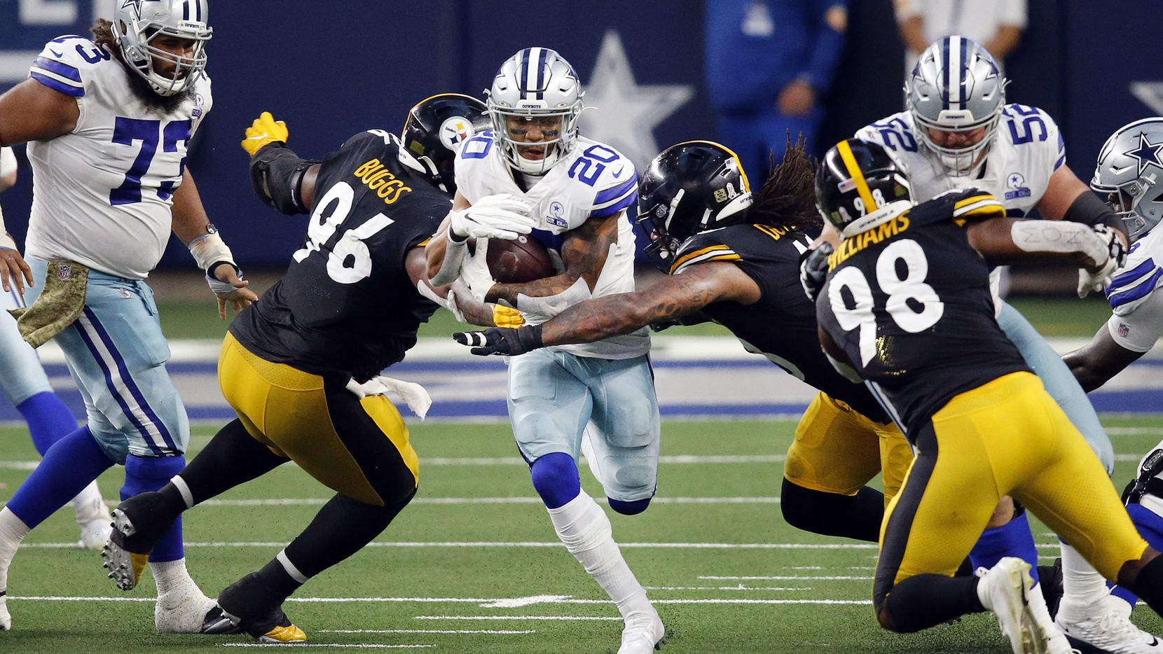 Cowboys running back Tony Pollard (20) runs through a hole in the Steelers' defense during the third quarter at AT&T Stadium in Arlington on Sunday, Nov. 8, 2020.