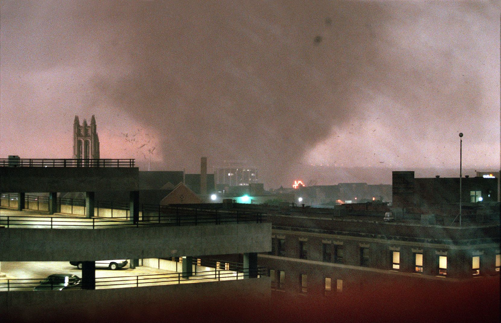 A tornado crosses the Trinity River on the west side of Fort Worth and heads for downtown on March 28, 2000. The Mallick Tower is pictured just at the base of the tornado.