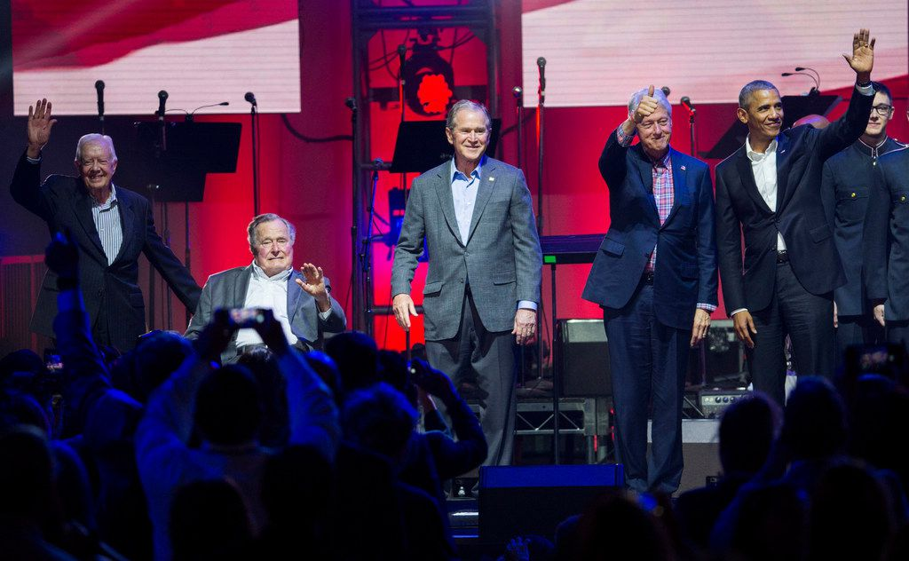 Former presidents Jimmy Carter, George H. W. Bush, George W. Bush, Bill Clinton and Barack Obama wave to audience members during Deep from the Heart: The One America Appeal Concert on Saturday, October 21, 2017 at Reed Arena on the Texas A&M University campus in College Station, Texas. The concert was a fundraiser to offer relief for victims of recent hurricanes in Texas, Florida and Puerto Rico. Former presidents Jimmy Carter, George H. W. Bush, Bill Clinton, George W. Bush and Barack Obama attended the event. (Ashley Landis/The Dallas Morning News)
