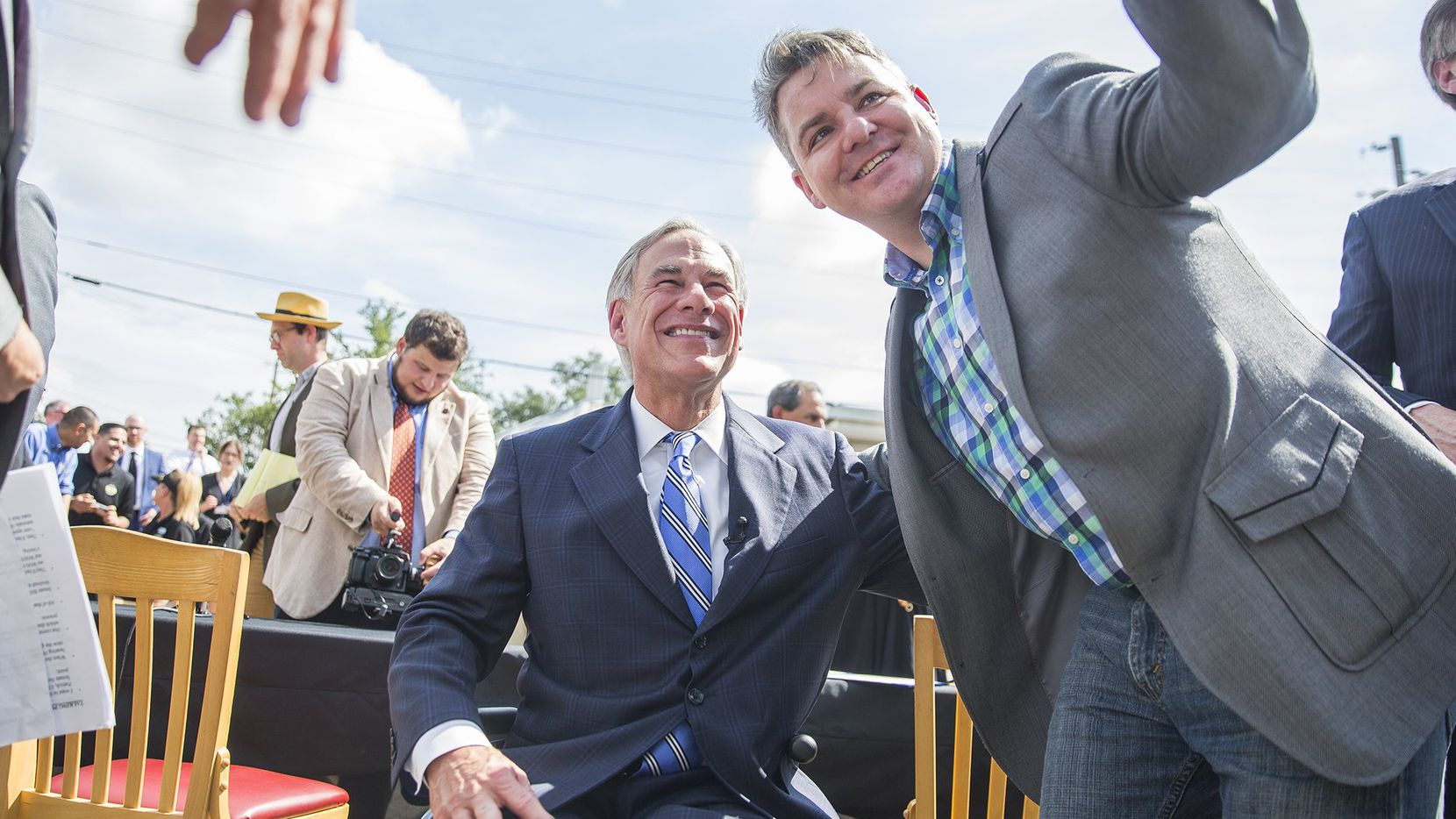 Nathaniel Mayfield takes a photo with Governor Greg Abbott after he signed a bill that limits property tax growth.  Wednesday, June 12, 2019.