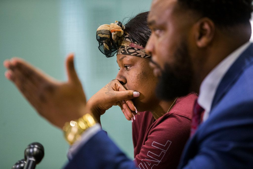 L'Daijohnique Lee, left, with her lawyer, civil rights attorney Lee Merritt, during a press conference in Dallas last week. Lee now faces a charge of criminal mischief. Police say she admitted smashing a window in her allege attacker's pickup.