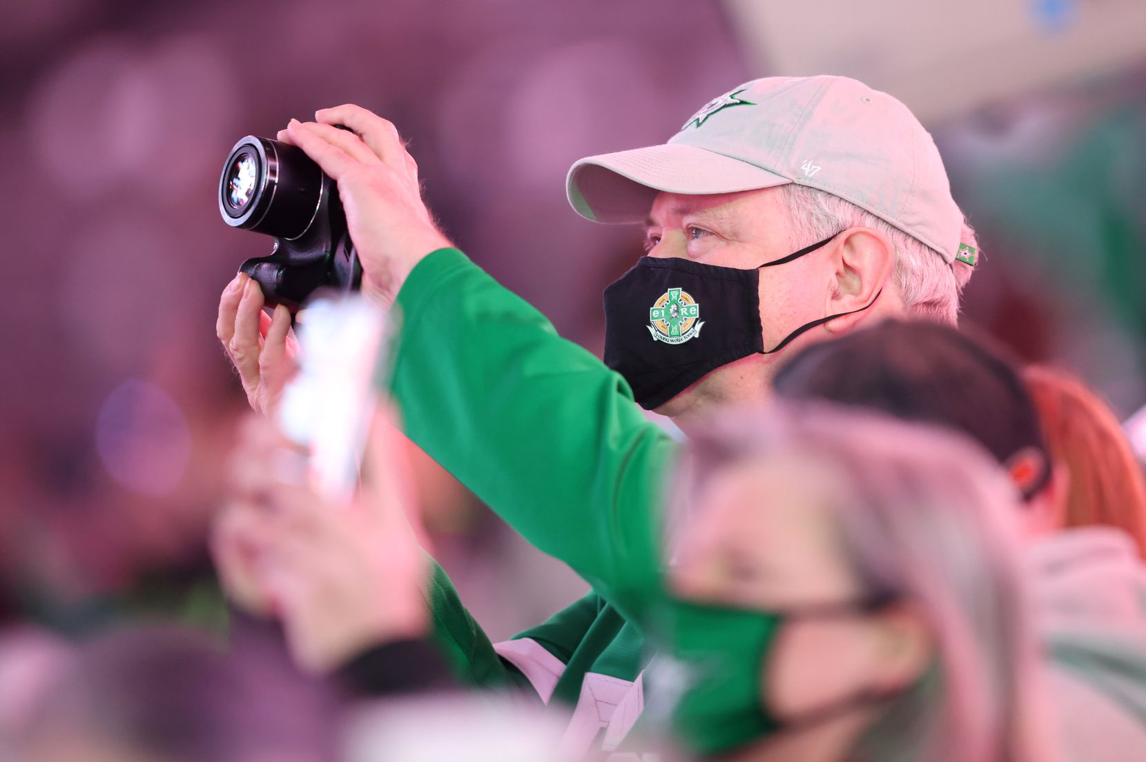 Dallas Stars fans take photos of the Western Conference Champions banner prior to the start of a game against the Nashville Predators in the Stars home opener at American Airlines Center on Friday, January 22, 2021in Dallas. (Vernon Bryant/The Dallas Morning News)