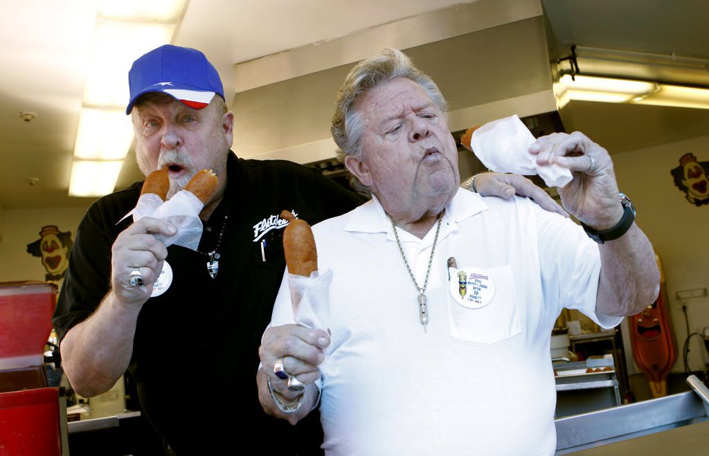 Fletcher brothers, Bill (left) and Skip (right) taste test their first corny dogs on the 70th anniversary of the corny dog at the main Fletcher Corny Dog stand at the State Fair of Texas on Wednesday, September 26, 2012.  (Lara Solt/The Dallas Morning News)