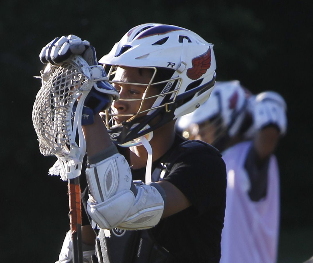 Marcus Johnson takes a short breather between drills with other members of the Bridge Eagles lacrosse team. The Bridge lacrosse team held their Wednesday evening practice session at the JC Phelps Recreation Center in Dallas on May 5, 2021.