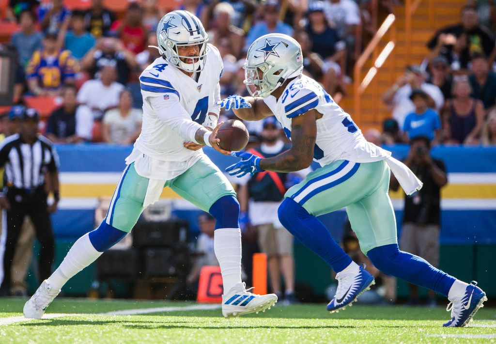 Dak Prescott (4) hands the ball off to Tony Pollard (36) during the first quarter of the Cowboys' preseason game against the LA Rams on Friday, Aug. 17, 2019, at Aloha Stadium in Honolulu, Hawaii. (Ashley Landis/The Dallas Morning News)