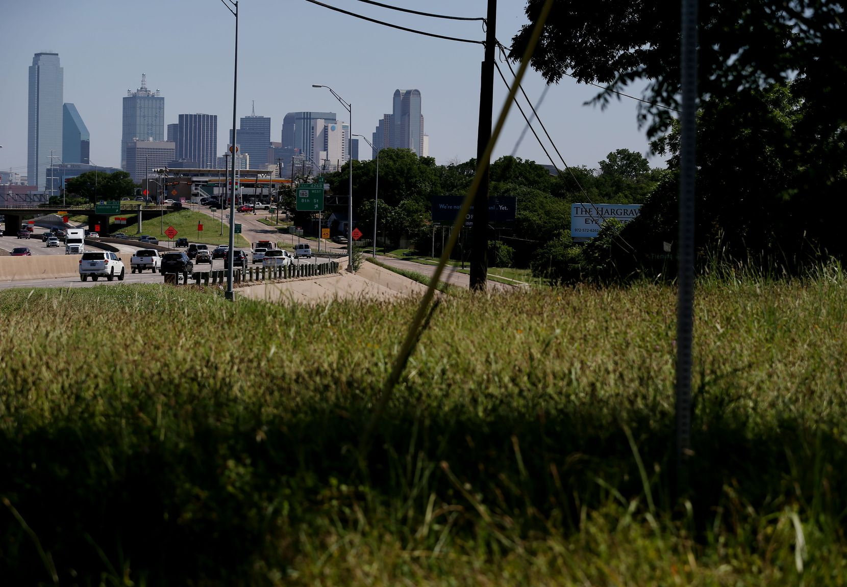 The view of downtown Dallas, near the corner of  E. 11th Street and Fleming Avenue on the east side of Interstate 35 in the Tenth Street Historic District, on June 22, 2016.