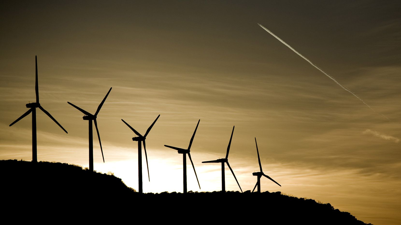 Wind turbines built by General Electric lined up on a mesa in Nolan County outside of Sweetwater, Texas, Feb. 12, 2008.