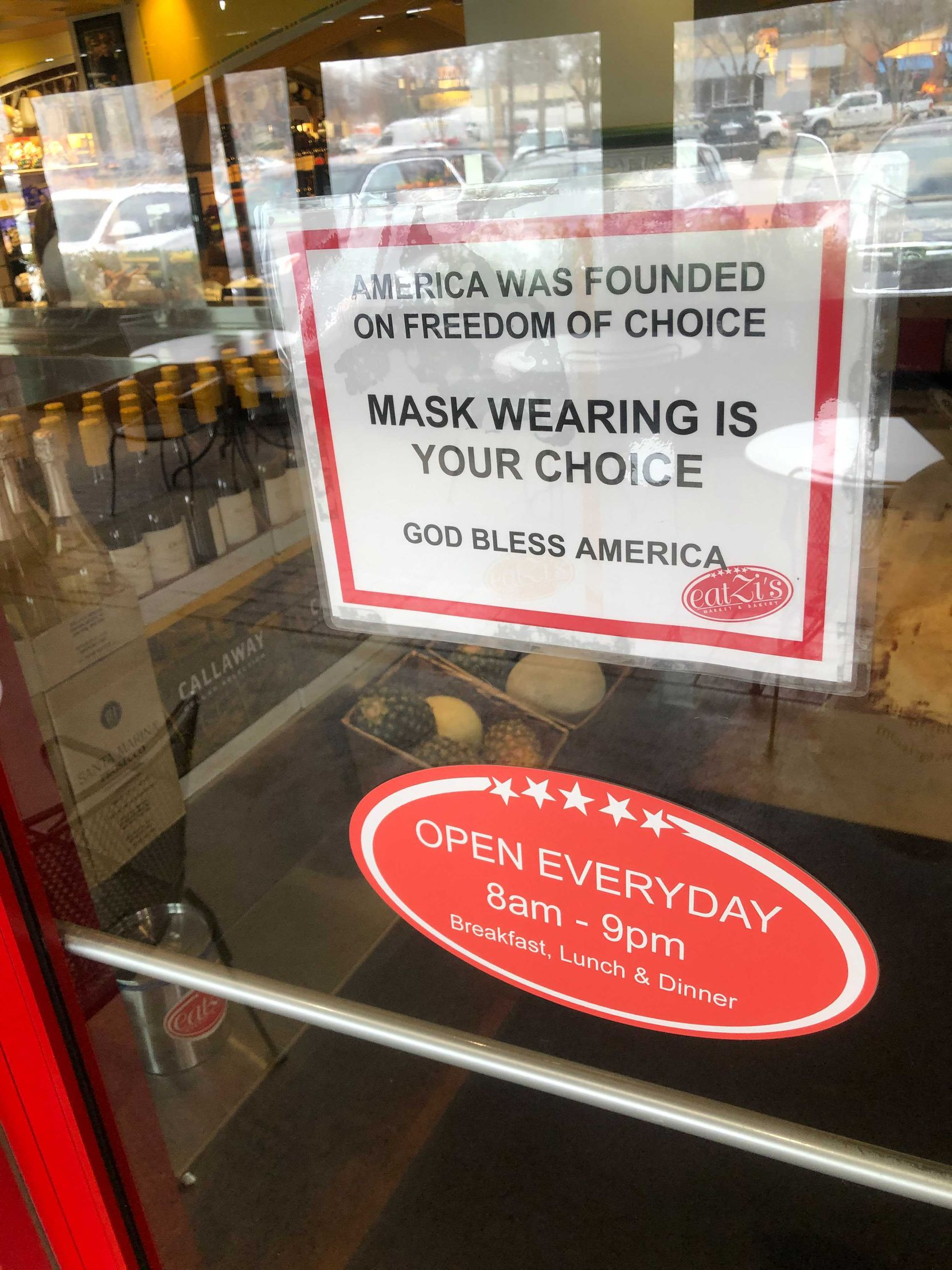 """A sign at Eatzi's on Lovers Lane says """"mask wearing is your choice."""""""