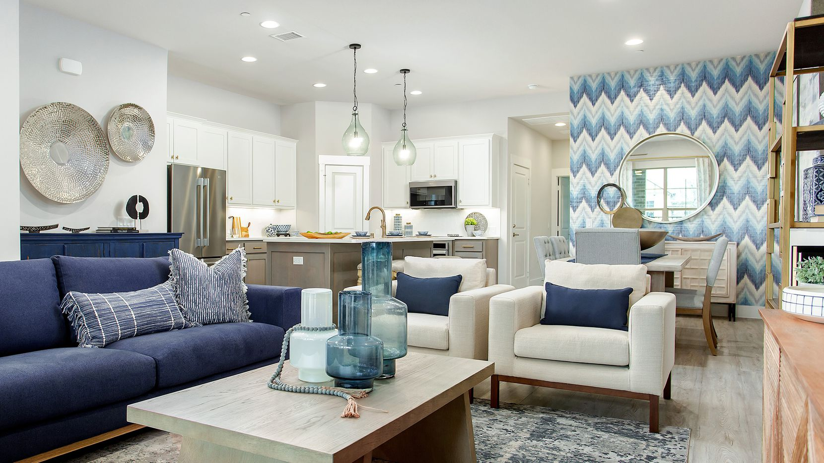 Luxury villas and townhomes by Grenadier Homes are priced from the high $200s in the Grand Prairie community of Mira Lagos.