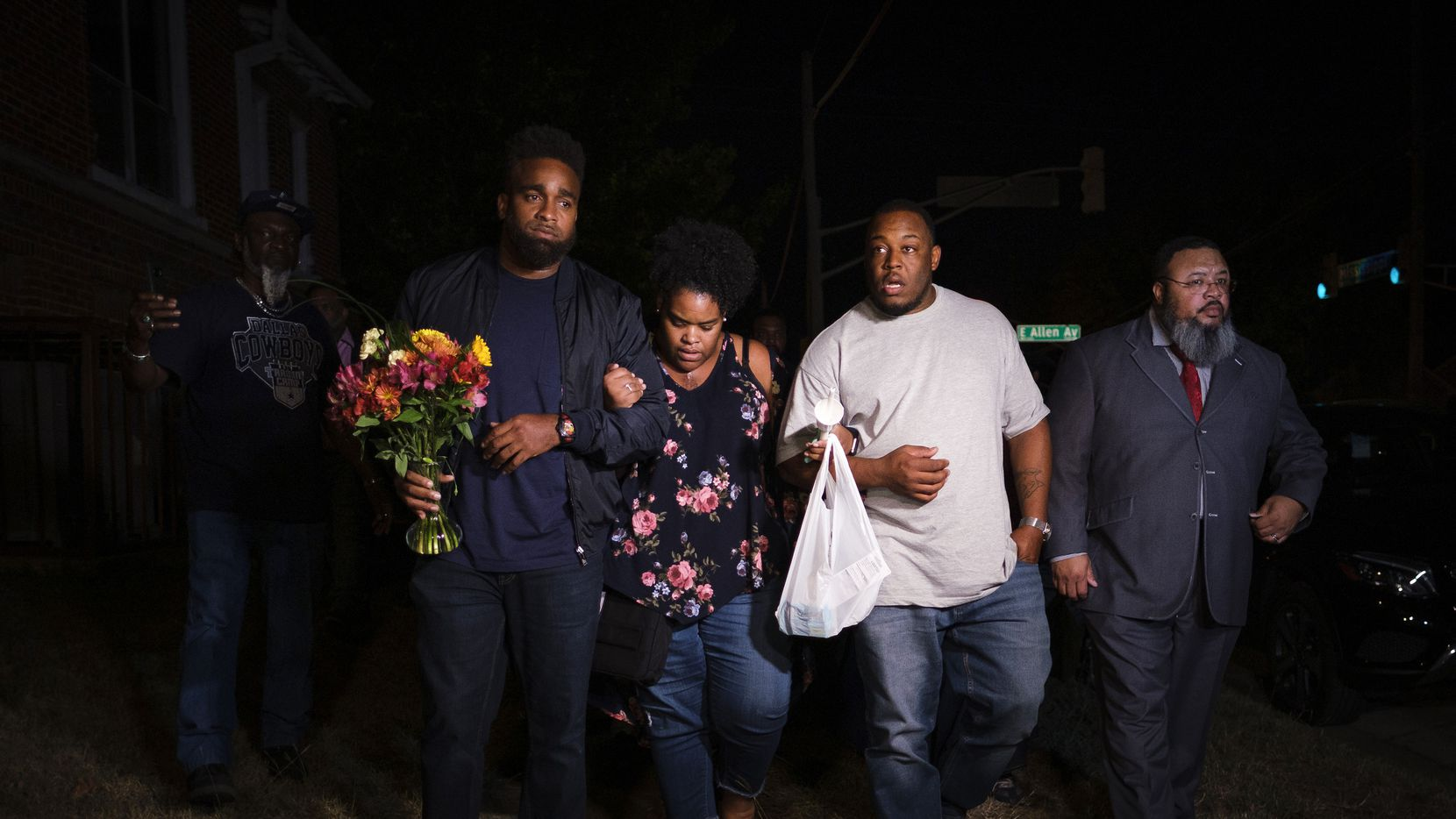 Members of the victim's family depart a community vigil for Atatiana Jefferson on Sunday, Oct. 13, 2019, in Fort Worth, Texas.  Jefferson, a 28-year-old black woman, was shot in her home by a white Fort Worth police officer during a welfare check.