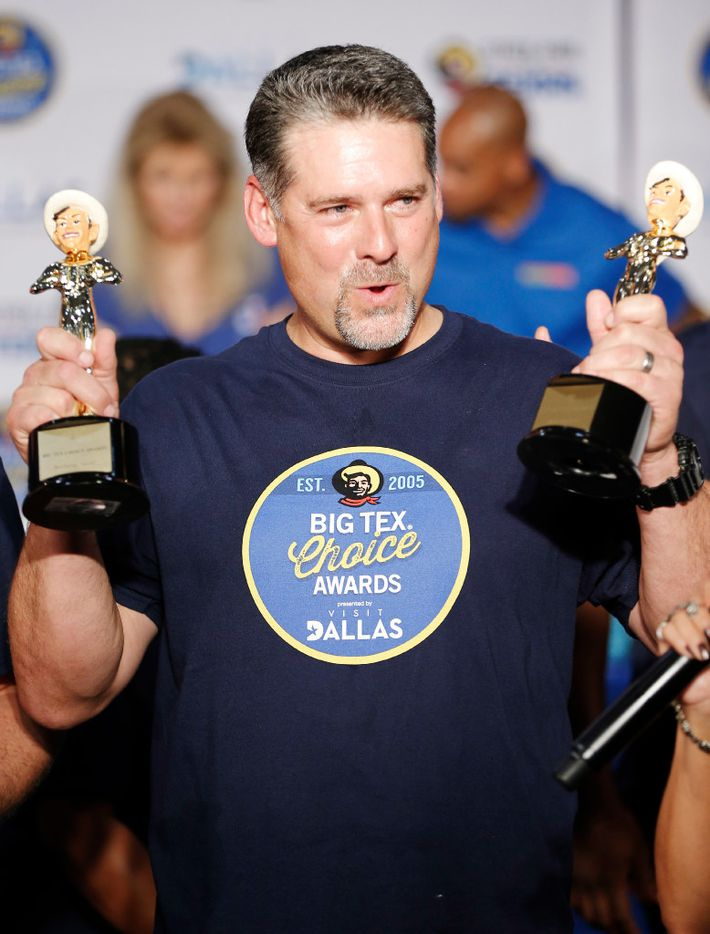 """Tom Grace celebrates winning both the """"Most Creative"""" and """"Best Taste - Savory"""" categories for his """"Funnel Cake Bacon Queso Burger"""" during the The Big Tex Choice Awards at Fair Park in Dallas, Sunday, August 27, 2017. (Brandon Wade/Special Contributor)"""