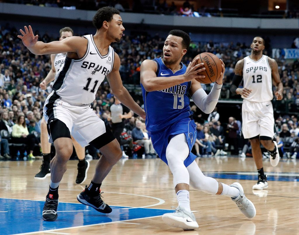 San Antonio Spurs guard Bryn Forbes (11) defends as Dallas Mavericks guard Jalen Brunson (13) works to the basket during the second half of an NBA basketball game in Dallas, Tuesday, March 12, 2019.(AP Photo/Tony Gutierrez)