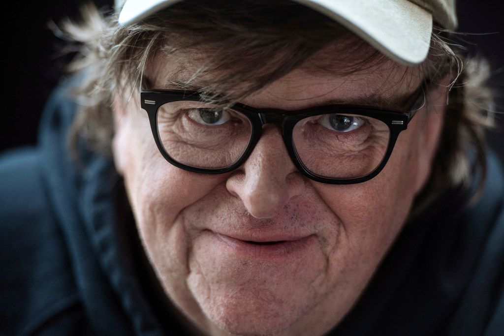 """Film director Michael Moore poses for a portrait while promoting his new movie, """"Fahrenheit 11/9,"""" during the Toronto International Film Festival in Toronto, Saturday, Sept. 8, 2018. (Galit Rodan/The Canadian Press via AP)"""