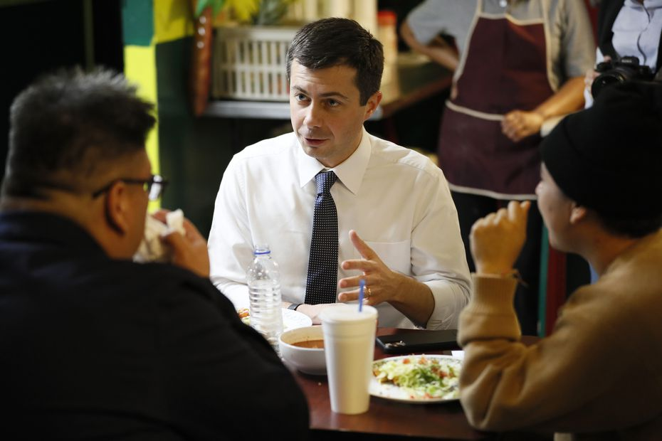 South Bend, Ind., Mayor Pete Buttigieg eats lunch with Iowa voters on Nov. 26, 2019, in Denison.