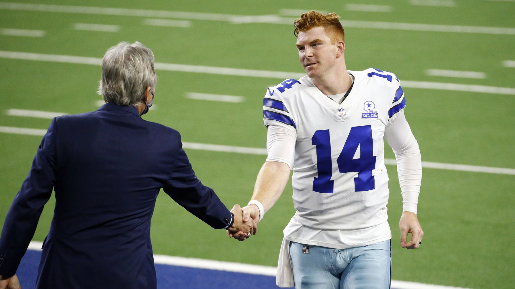Dallas Cowboys quarterback Andy Dalton (14) receives congratulations on the teams win over the New York Giants at AT&T Stadium Stadium in Arlington, Texas, Sunday, October 11, 2020.