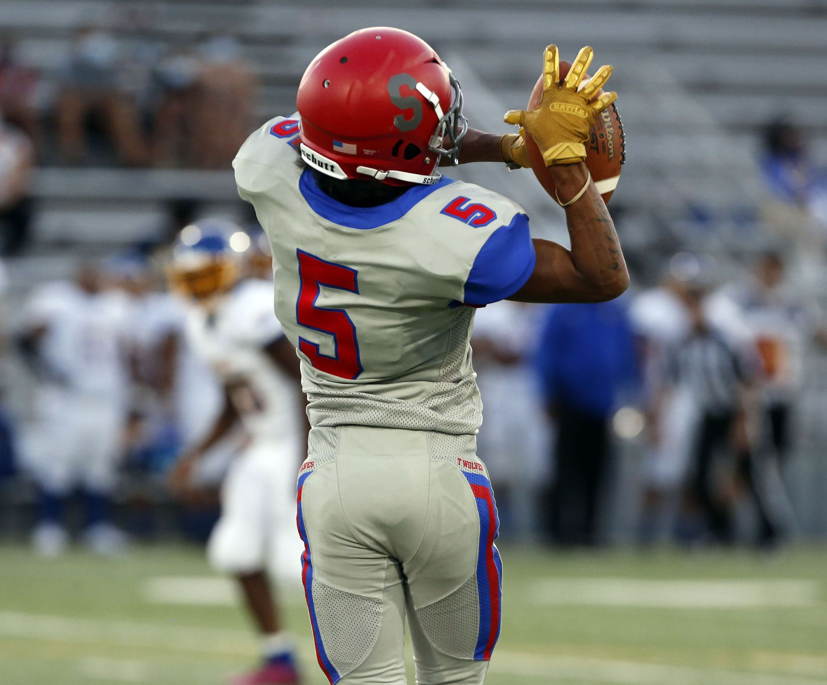 Spruce High Wilbert Trigg (5) grabs a pass during the first half of the season opening high school football game between against Samuell and Spruce High at Pleasant Grove Stadium in Dallas on Friday, August 27, 2021. (John F. Rhodes / Special Contributor)