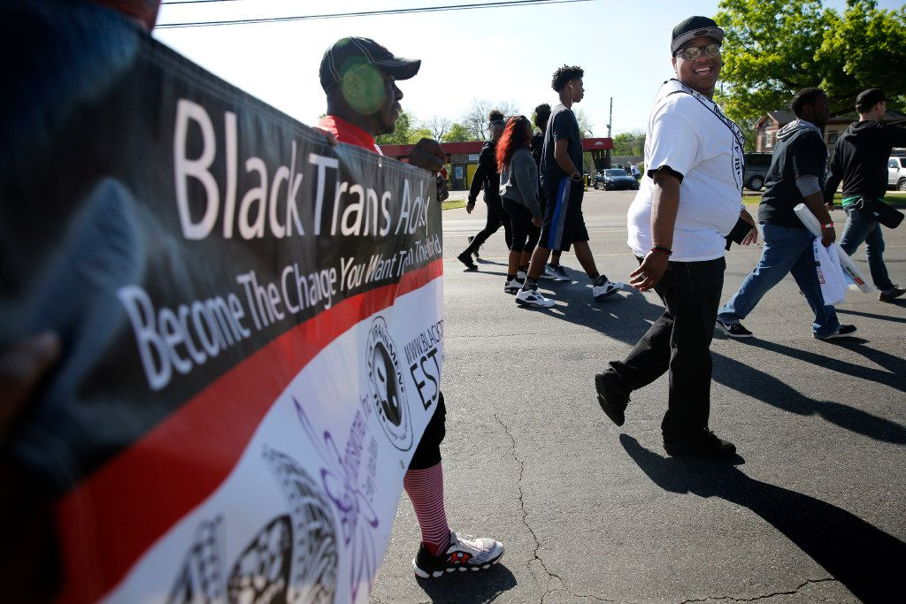 Trenton Johnson (far right), a transgender man, participates in the AIDS Walk South Dallas with other Black Trans Advocacy members near the Martin Luther King, Jr. Community Center in South Dallas on Saturday.
