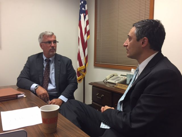 Badger (left) meets with the roofing bill sponsor, State Rep. Giovanni Capriglione, R-Southlake, in Gio's conference room in Austin. Topic of discussion? How to get House Bill 3293 through the Texas House.