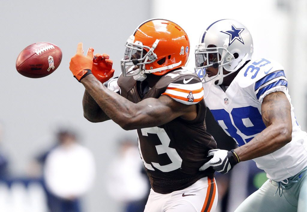 Dallas Cowboys cornerback Brandon Carr (39) breaks up a pass intended for Cleveland Browns wide receiver Josh Gordon (13) during the first half of play at Cowboys Stadium in Arlington on Sunday, November 18, 2012. (Vernon Bryant/The Dallas Morning News)