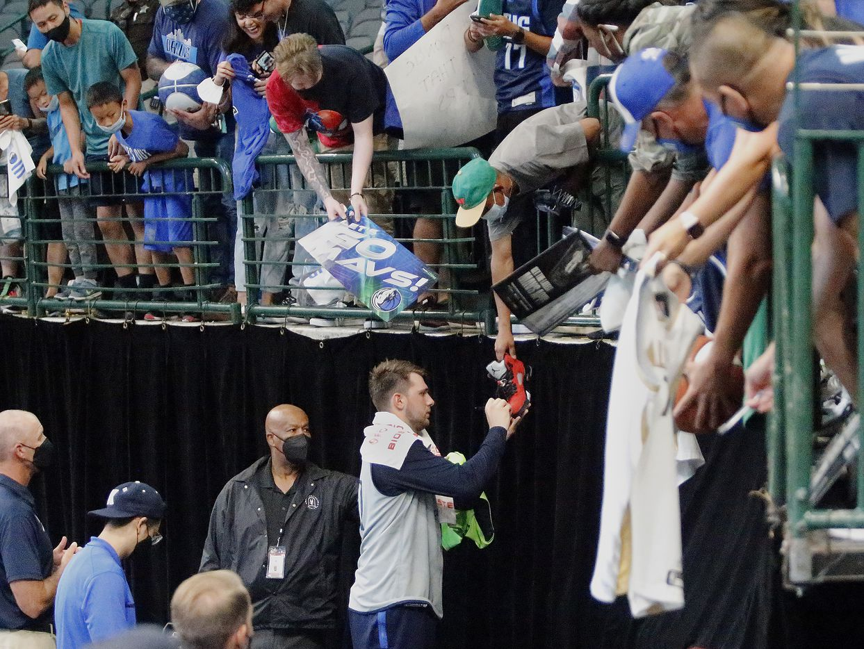 Dallas Mavericks guard Luka Doncic (77) autographs a shoe for one of the fans after the event as the Dallas Mavericks held their Mavs Fam Jam, a scrimmage free to the public at the American Airlines Center in Dallas on Sunday, October 3, 2021. (Stewart F. House/Special Contributor)