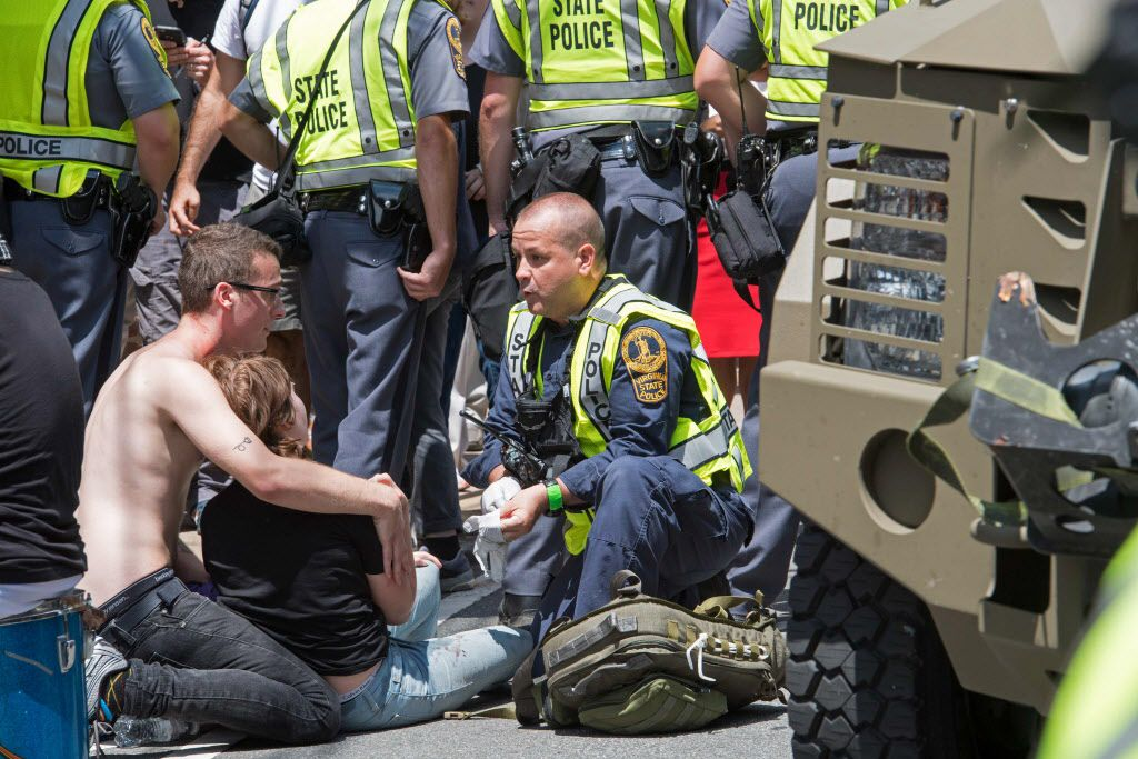 People receive first-aid after a car accident ran into a crowd of protesters in Charlottesville, VA on August 12, 2017.  A picturesque Virginia city braced Saturday for a flood of white nationalist demonstrators as well as counter-protesters, declaring a local emergency as law enforcement attempted to quell early violent clashes.  / AFP PHOTO / PAUL J. RICHARDSPAUL J. RICHARDS/AFP/Getty Images