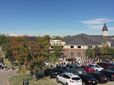 The line for early voting at a polling place in Oklahoma County wraps around the Edmond Church of Christ and more, Friday, Oct. 30, 2020, in Edmond, Okla. Voters at the front of the line were reporting five-hour waits. (AP Photo/Sue Ogrocki)