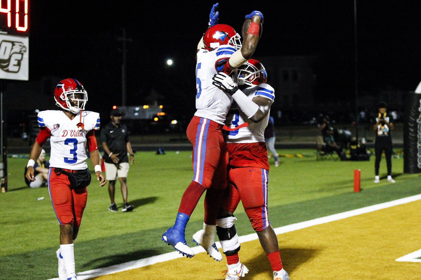 Duncanville senior running back Malachi Medlock (5) is congratulated by senior offensive lineman Jaylen Early, right, after scoring a touchdown during the second half of a high school football game against DeSoto at DeSoto High School, Friday, September 17, 2021. Duncanville won 42-21. (Brandon Wade/Special Contributor)