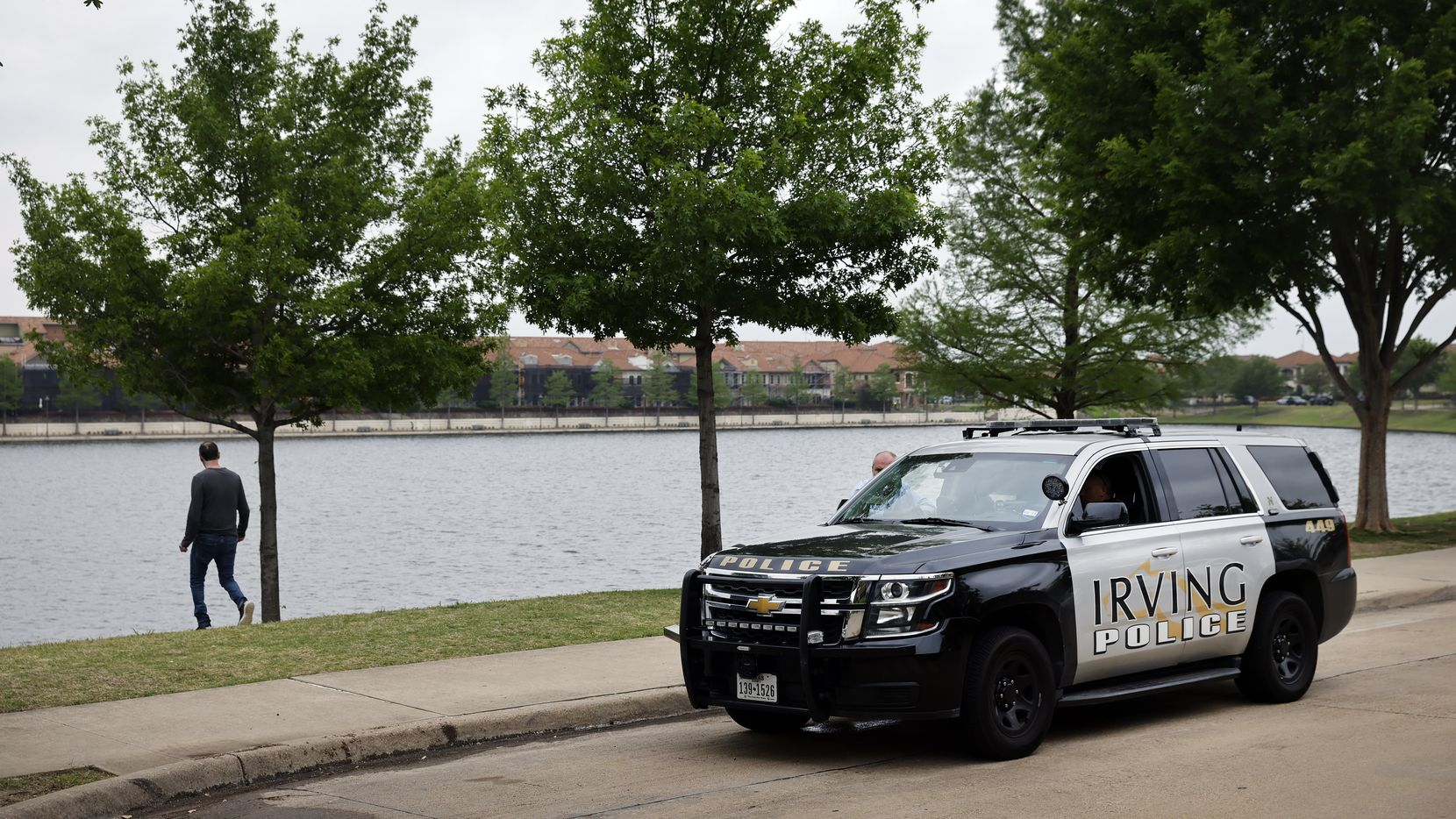 An Irving police officer is pictured along Lago de Claire where Lashun Massey went missing across the street from her Las Colinas home in Irving on Tuesday.