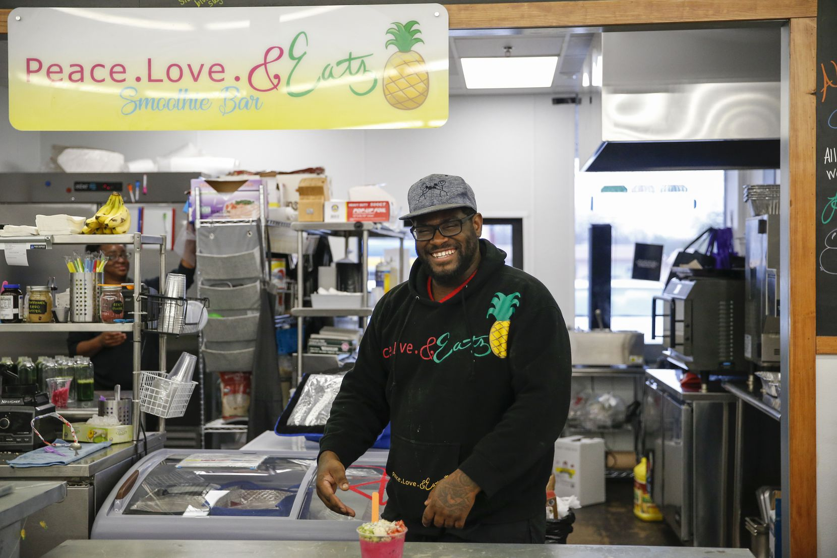 James McGee poses for a photograph at Peace Love Eatz in Grow DeSoto Marketplace on Wednesday, Jan 22, 2020 in DeSoto, Texas. (Ryan Michalesko/The Dallas Morning News)