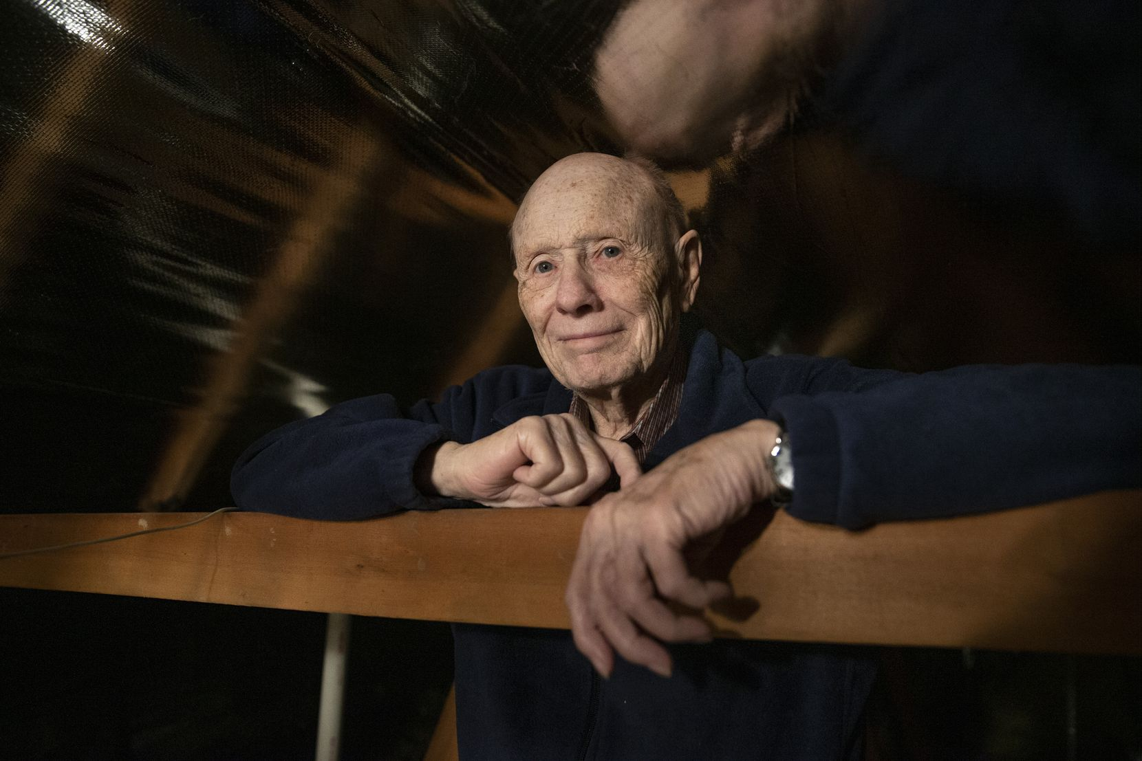 Alan Oldfield, 84, in the attic of his Bedford home. Oldfield said he was taken advantage of by Abe Issa's solar energy company into taking out a loan to pay for a weatherization project on Oldfield's home.