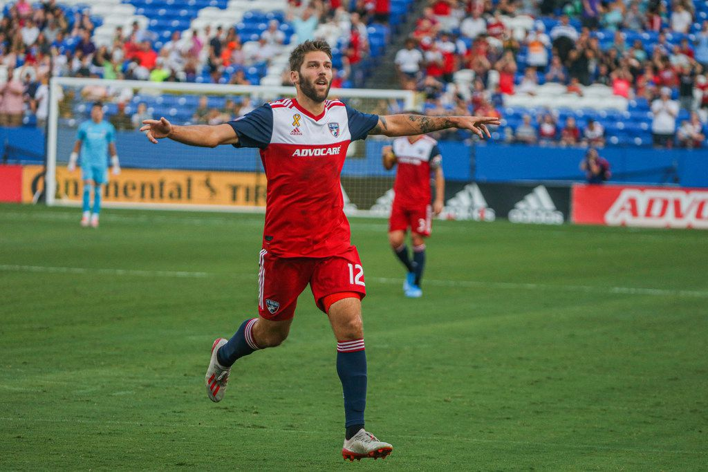 FC Dallas midfielder Ryan Hollingshead (12) celebrates after scoring a goal during the first half of an MLS game between FC Dallas and FC Cincinnati on Saturday, August 31, 2019 at Toyota Stadium in Frisco, Texas.