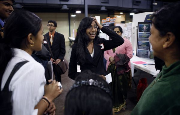 Monisha Veerapaneni of Plano reacts to hearing of awards for her project on atherosclerosis, an artery disorder, at the Beal Bank Dallas Regional Science and Engineering Fair.