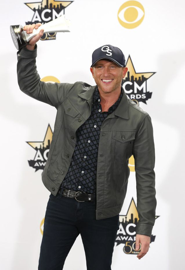 Cole Swindel poses for a photo with his New Artist of the Year award during the 2015 Academy of Country Music Awards Sunday, April 19, 2015 at AT&T Stadium in Arlington, Texas.
