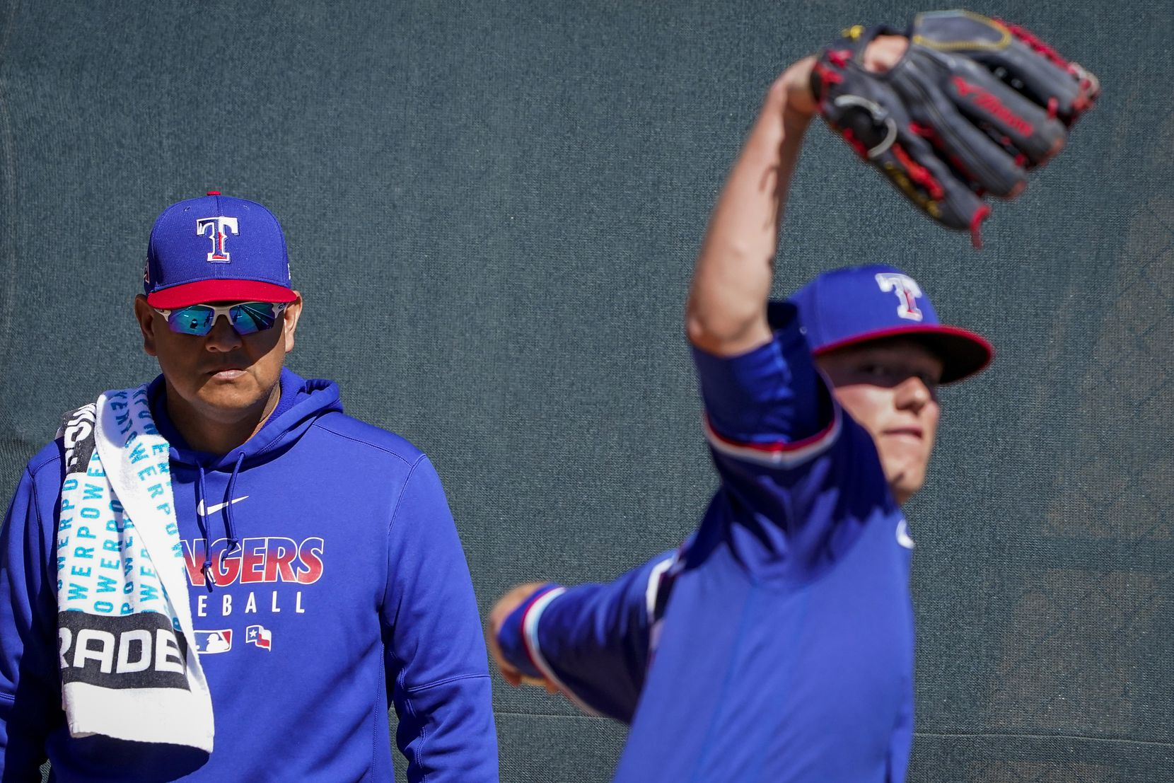 Texas Rangers pitching coach Julio Rangel watches pitcher Kolby Allard warm up in the bullpen before a spring training game against the Colorado Rockies at Salt River Fields at Talking Stick on Wednesday, Feb. 26, 2020, in Scottsdale, Ariz.