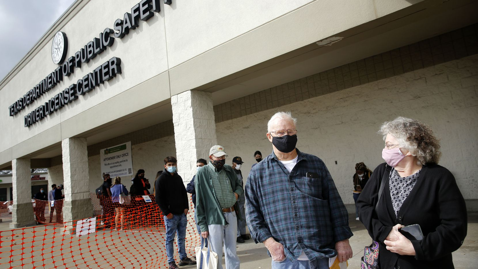 Wearing masks outside, Robert and Connie Clark of Garland wait in line to have their licenses renewed at the Texas Department of Public Safety Drivers License Center in Garland, Texas, Wednesday, March 10, 2021. Today is the first day of Governor Greg  Abbott's lifting of the mask mandate and other restrictions. (Tom Fox/The Dallas Morning News)