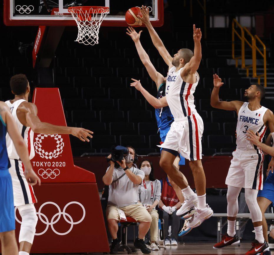 Slovenia's Klemenn Prepelic (7) last second shot is blocked by France's Nicolas Batum (5) of a men's basketball semifinal on Thursday, August 5, 2021, in Saitama, Japan.