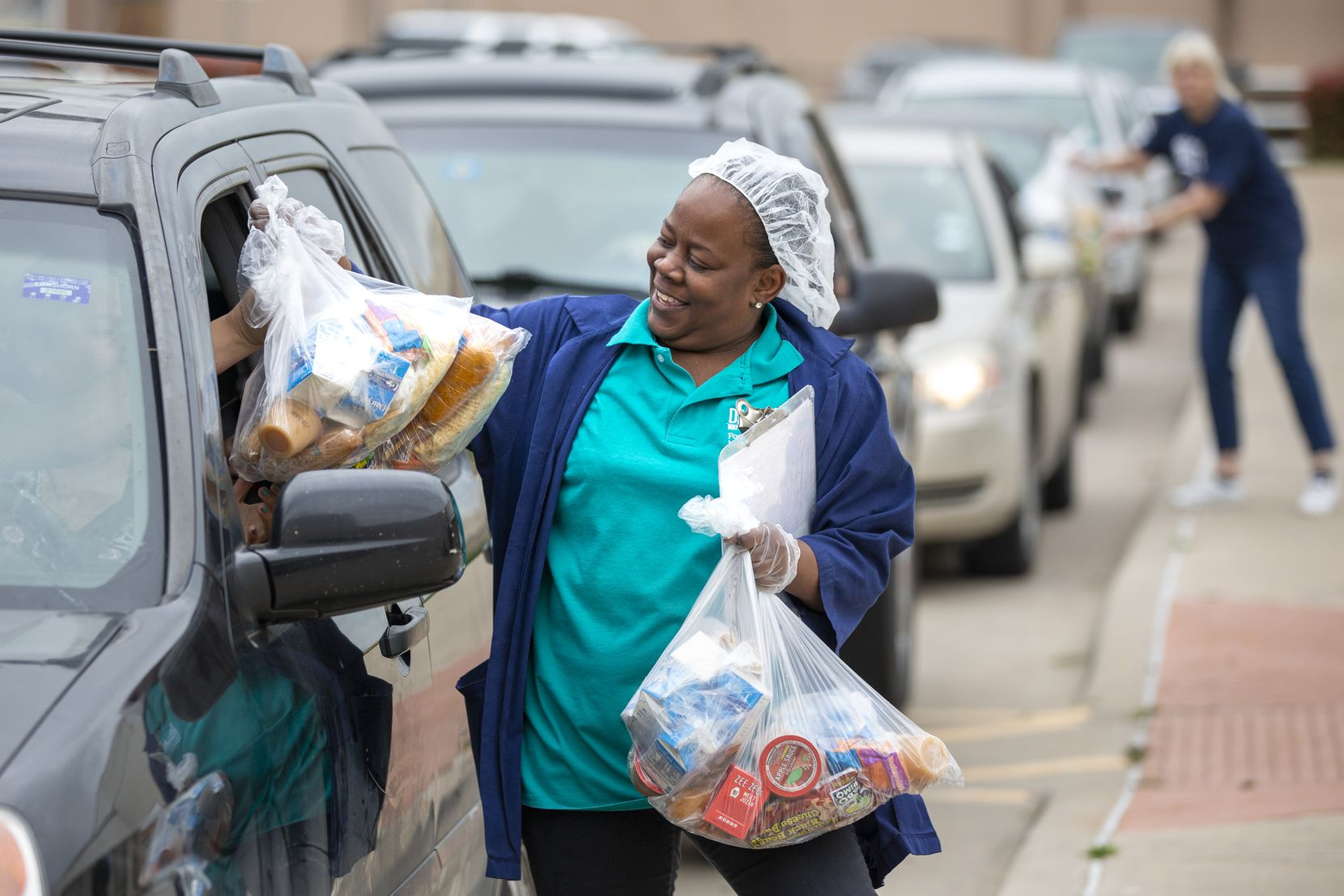 Food service supervisor Latoncia Anderson distributes meals.