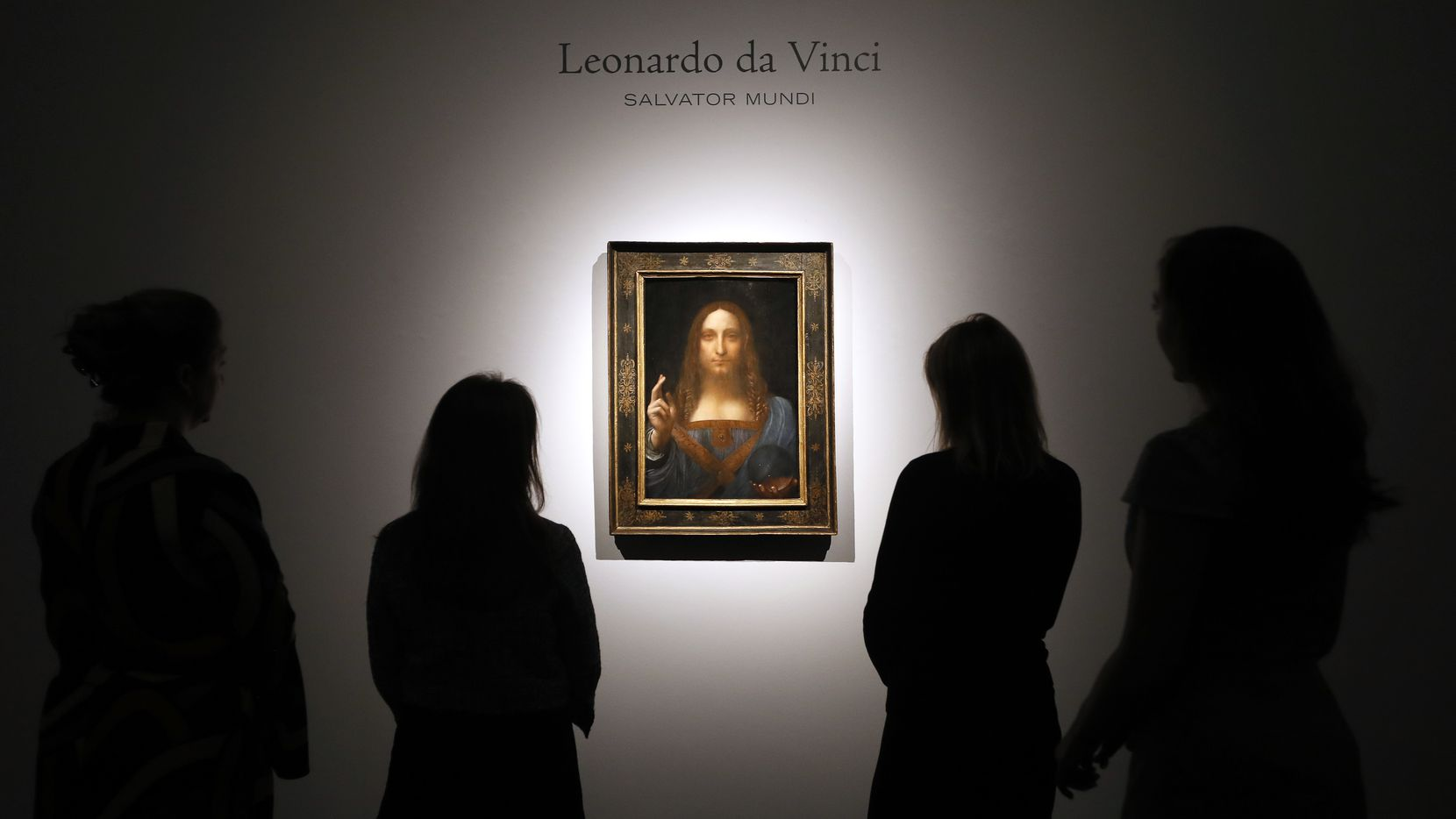 People gathered around Leonardo da Vinci's 'Salvator Mundi' at a Christie's auction room in London in October 2017. For eight months in 2012, the painting lingered in a storeroom at the Dallas Museum of Art, not being shown to the general public. So, Curious Texas asks the question: Why? Why is so much art kept in storage?