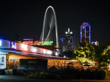 Exterior view Trinity Groves with downtown and the Margaret Hunt Hill Bridge seen at night on  Aug. 13, 2020, in Dallas. (Smiley N. Pool/The Dallas Morning News)