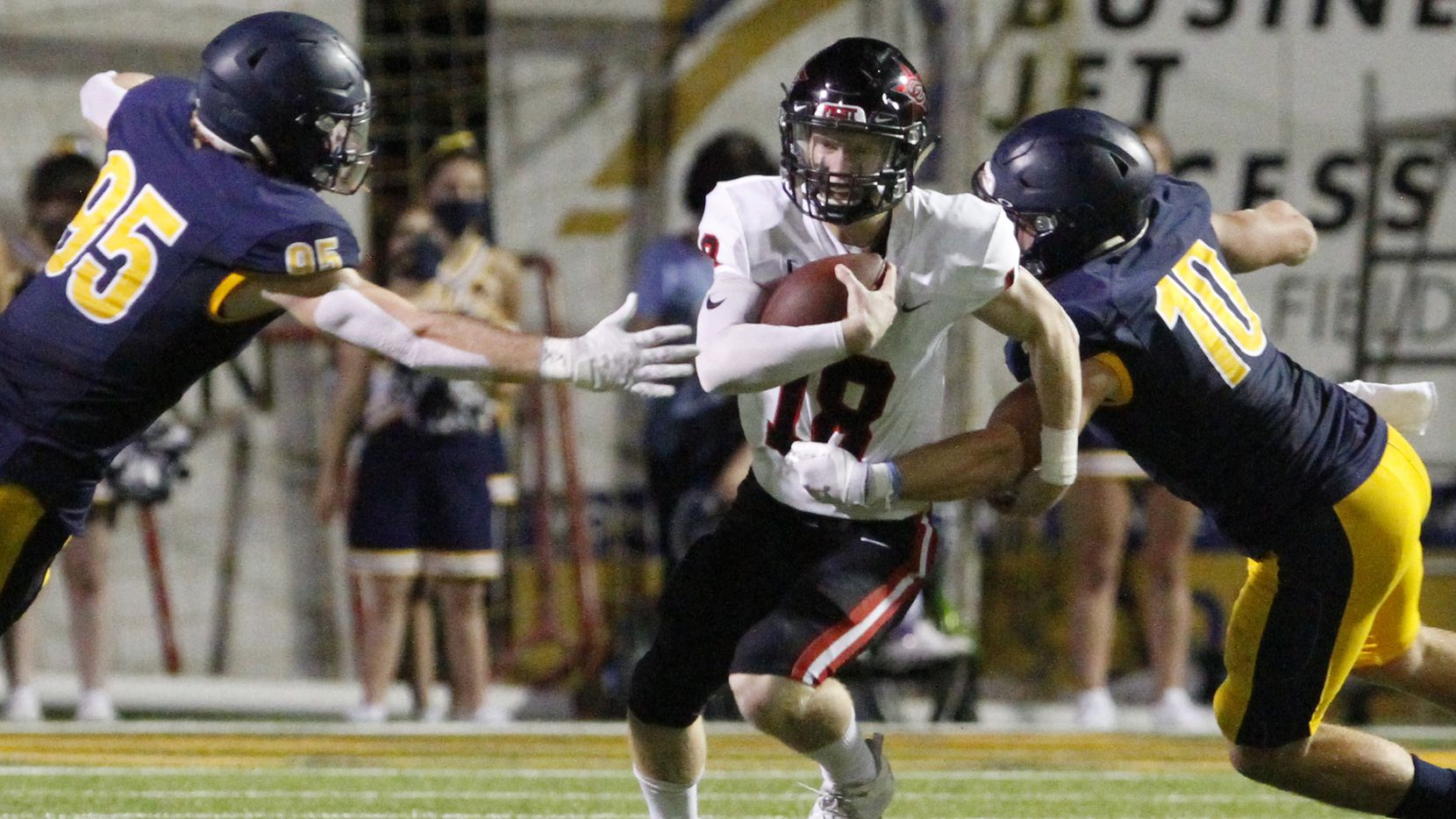 Coppell senior quarterback Ryan Walker (18) is nearly sacked on a play by Highland Park defenders  junior Jack Curtis (95) and senior Marshall Landwehr (10) during the first half of a non-district football game, on Friday night, Oct. 09, 2020 at Highland Park High School in Dallas.