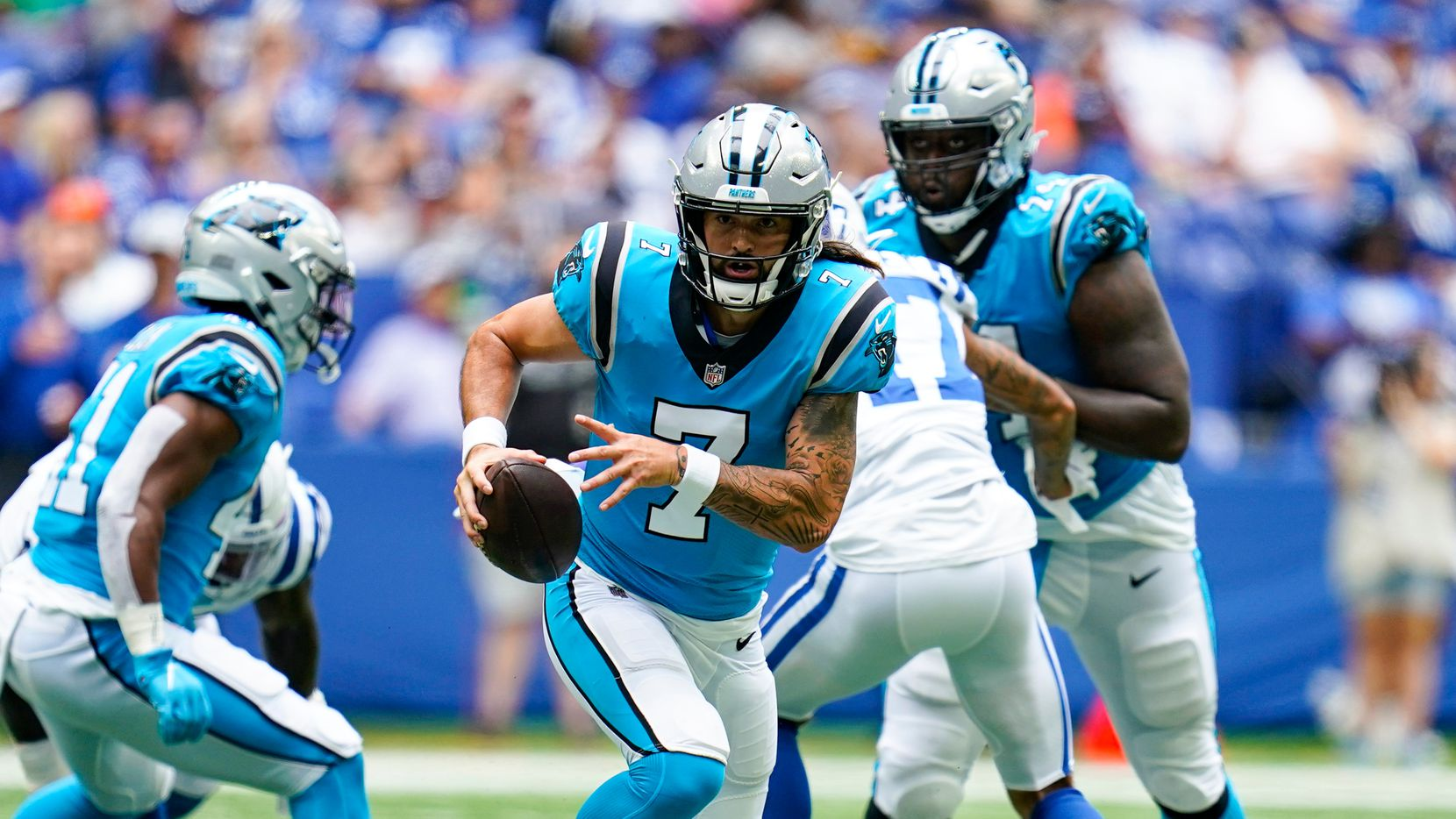 Carolina Panthers quarterback Will Grier (7) scrambles against the Indianapolis Colts during the second half of an NFL exhibition football game in Indianapolis, Sunday, Aug. 15, 2021.